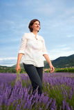 Woman walking through lavender field Royalty Free Stock Photo