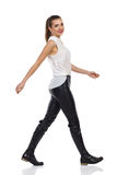 Woman walking In Leather Trousers Stock Photography