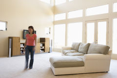 Woman walking through living room Royalty Free Stock Images