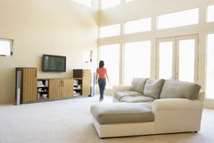 Woman walking through living room Royalty Free Stock Photos
