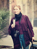 Woman walking looking curious in the city Stock Images