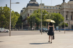 Woman walking by Madrid City streets with umbrella Stock Photography