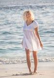 Woman is walking on the Maldivian beach Royalty Free Stock Image