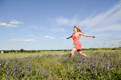 Woman walking on meadow Royalty Free Stock Photography