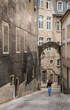 Woman walking on a medieval street in Luxembourg Royalty Free Stock Photo