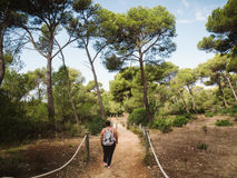 Woman walking in mediterranean forest Stock Photo