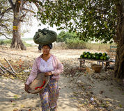 A woman walking at Mingun village in Mandalay, Myanmar Stock Images