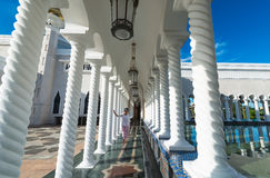 Woman walking in Mosque of Sultan Omar Ali Saifuddin  in Brunei Royalty Free Stock Image