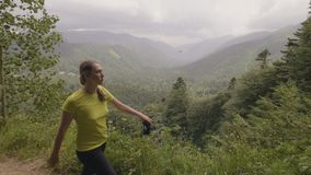 Woman walking mountain trail with beautiful landscape while hiking tour stock video footage