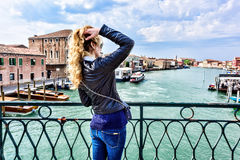 Woman walking in Murano island Italy. Traveler or tourist girl exploring the city Royalty Free Stock Images