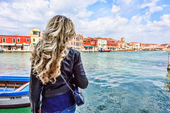 Woman walking in Murano island Italy. Traveler or tourist girl exploring the city Stock Image