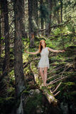 Woman walking in the mystery forest Stock Photography