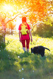 Woman walking in nature with his dog Royalty Free Stock Photos