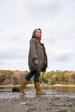 Woman walking near a lake and forest stock images