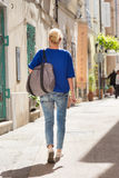 Woman walking on old cobbled street. Woman walking on old traditional cobbled street in old coastal town of Piran in Slovenia, Europe Royalty Free Stock Photo