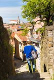 Woman walking on old cobbled street. Woman walking on old traditional cobbled street in old coastal town of Piran in Slovenia, Europe Royalty Free Stock Photography