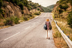 Woman Walking On The Road Royalty Free Stock Photos