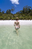 Woman walking out of lake. Woman wading out of fresh water lake in australia basin lake fraser island Royalty Free Stock Photo
