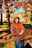 Woman walking outdoor in autumn park. Stock Photo