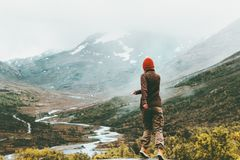 Woman walking outdoor foggy mountains on background Royalty Free Stock Image
