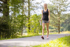 Woman walking outdoor in the forest as workout Stock Images