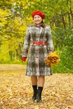Woman  walking outdoors in autumn Stock Images