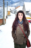 Woman walking outside in winter time. Beautiful young woman walking outside in winter time Royalty Free Stock Photography