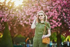 Woman walking in Paris on a spring day stock image