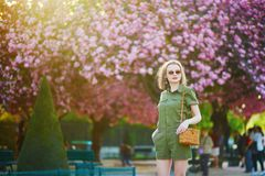 Woman walking in Paris on a spring day royalty free stock images