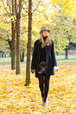 Woman walking in park Stock Photo