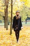 Woman walking in park Stock Photo
