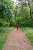 Woman walking in park Royalty Free Stock Images