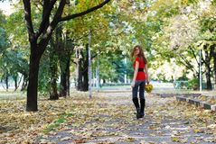 Woman walking in park Stock Image