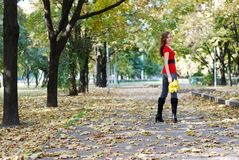 Woman walking in park Royalty Free Stock Photos