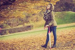 Woman walking in park during autumn royalty free stock images