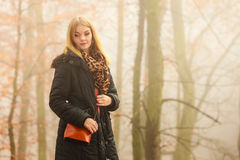 Woman walking in park in foggy day Royalty Free Stock Photography