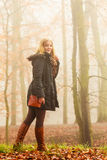 Woman walking in park in foggy day Stock Photography