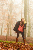 Woman walking in park in foggy day Stock Image