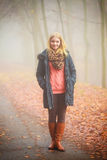 Woman walking in park in foggy day Royalty Free Stock Images