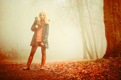 Woman walking in park in foggy day Royalty Free Stock Photo