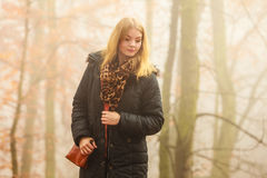 Woman walking in park in foggy day Stock Photos