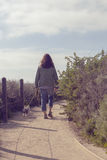 Woman walking in the park with her pet dog Royalty Free Stock Photo