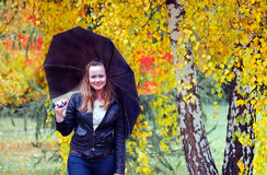 Woman walking in park Stock Photos
