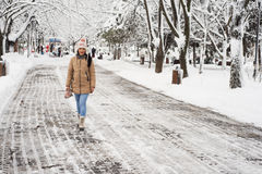 Woman walking in  park with snow Royalty Free Stock Images