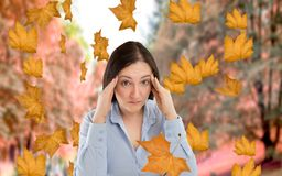 I am stressed by the autumn. Woman walking in a park and stressed by the arrival of autumn Royalty Free Stock Photo