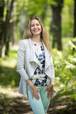 Woman walking in a park, summer time Royalty Free Stock Photos