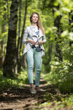 Woman walking in a park, summer time Stock Photos