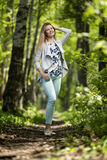 Woman walking in a park, summer time Stock Images