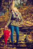 Woman walking in park with umbrella Royalty Free Stock Images