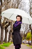 Woman walking in park under white umbrella Stock Photography
